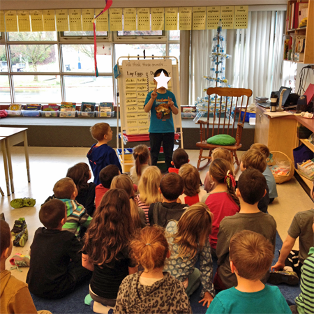 Kids playing a classroom game to practice counting by twos. This idea was adapted from the book Move to Learn. This is a book review by Grade ONEderful.