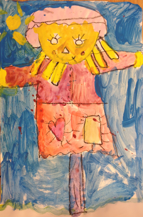 A free scarecrow poem for Grades K-2 and a scarecrow art project.